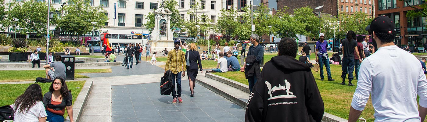 people in Manchester Piccadilly Gardens