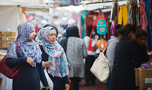 Muslim women shopping at Longsight market